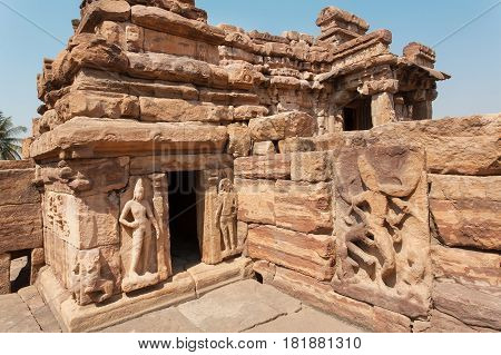 Sculptures on ancient walls of Hindu temples architecture landmark in Pattadakal, India. UNESCO World Heritage site with stone carved temples of 7th and 8th-century