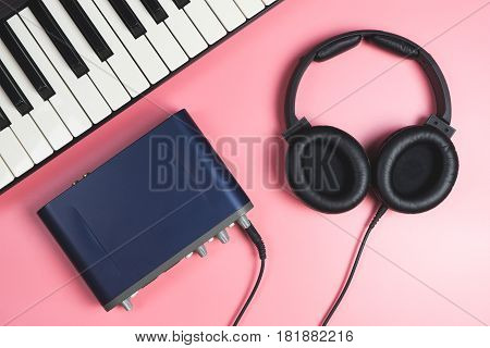 Computer Home Music studio set up on pink
