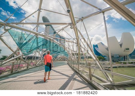 Single Tourist On Helix Bridge In Marina Bay, Singapore