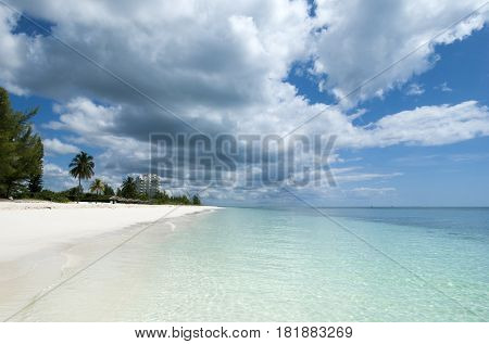 The endless Freeport town beach under heavy clouds (Grand Bahama Island).