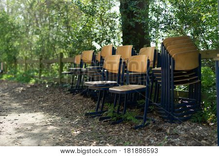 Wooden chairs outside in spring for cleaning under the trees