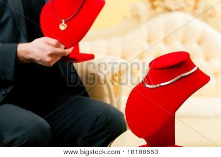 Shop assistant or owner of the store presenting jewellery
