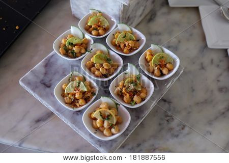 AGRA, INDIA - FEBRUARY 14 : Tray of appetizers. finger food served on platter. Various banquet snacks prepared for event party at luxury hotel Four Points by Sheraton Agra, India on February, 14, 2016.