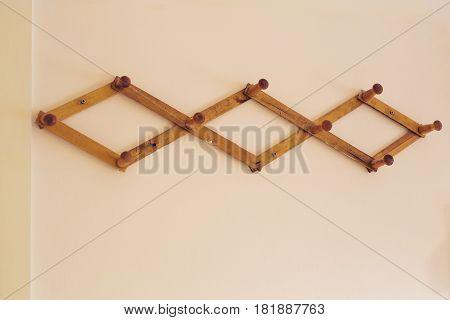 wooden hanger on the wall. Coat hanger on background