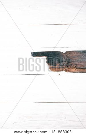 Pointer of natural wood on white painted wood board background. Space for your text and title