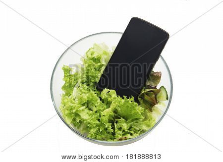 Smartphone In The Salad Isolated On White. Symbol Of Dependence On Social Networks, Putting Pictures