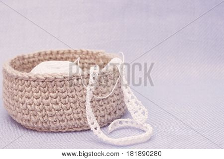 Natural crochet textile tutorial pattern. Linen rustic crochet box and white crochet lace. Thick ribbon cotton yarn