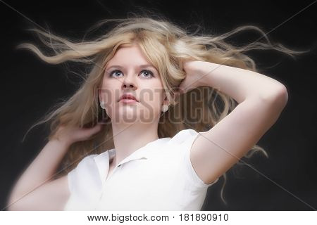 Blonde Woman With Her Hair Blowing