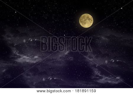 Beautiful magic blue sky with clouds and fullmoon and stars at night closeup.