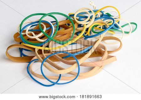 close up view of different coloured rubber bands