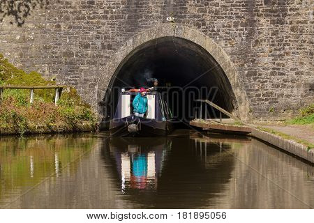Chirk United Kingdom - April 15 2017: Narrowboat exiting the 421 metre Chirk tunnel known locally as