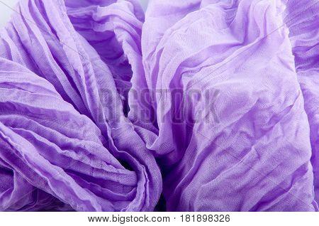 Background. Fragment of gathered purple soft waved fabric gathered