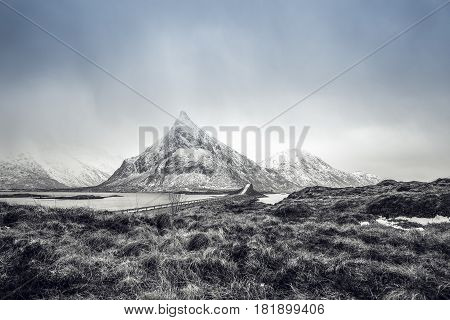Long road bridge. Beautiful Norway landscape. Lofoten islands. Black-white photo with blue sky.