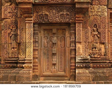 Intricatly carved stone door, temple at Banteay Srei, Cambodia