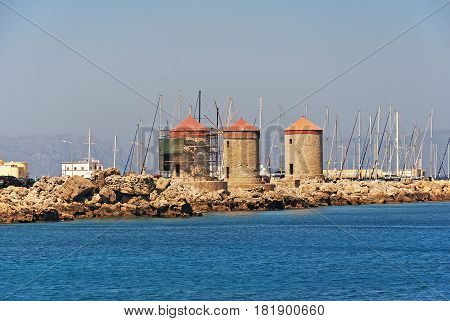 Traditional windmills in Mandraki port of Rhodes,Greece