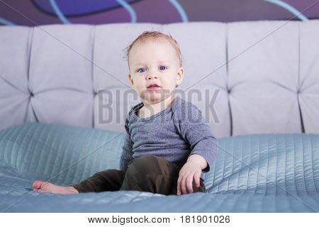 Serious Cute Infant Kid Looking At Camera. Adorable Baby Boy With Proud Look. Blue-eyed Delightful T