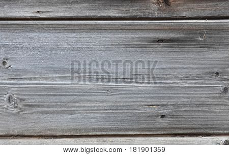 Background, wooden old boards, blackened with gray veins nails