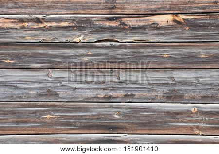 Background, wooden old boards blackened with brown veins nails