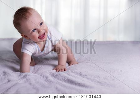 First Steps Of Funny Baby Boy. Cute Infant Kid Begining To Toddle. Cute Toddler In Good Mood. Copy S