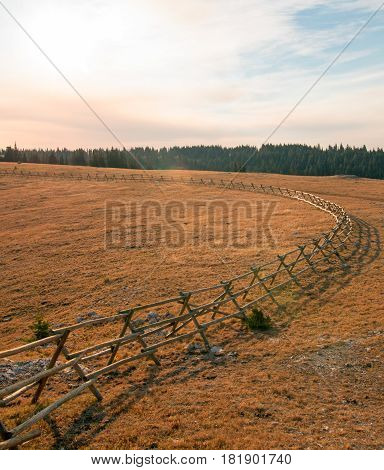 Split Rail wooden Fence at sunrise above Lost Water Canyon in the Pryor Mountains Wild Horse range on the Montana Wyoming state line USA