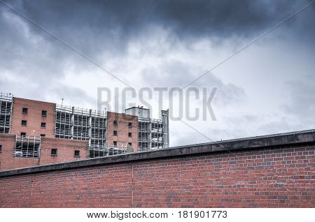 Multi storey car park and cloudy sky