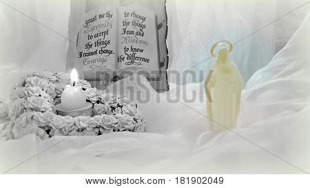Religious composition: the Bible, the word of Scripture, decorative hearts and a burning candle on a background of delicate veils
