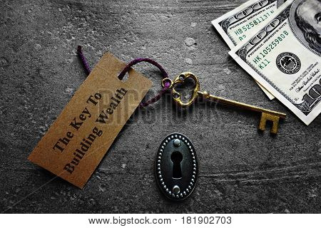 Key to building wealth with keyhole and money
