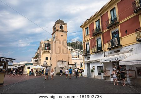 Capri Italy - August 31 2016: Tourists visit Piazza Umberto I the most famous square of the island of Capri.