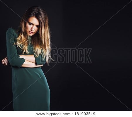 young blond real woman emotional in depression dark indoor, beautiful sadness copyspace
