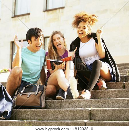 portrait of international group of students close up smiling, blond girl, asian boy, young african woman, back to school