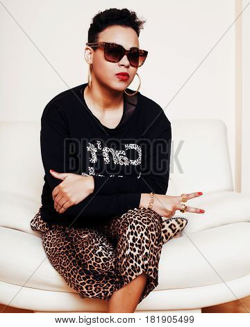 pretty stylish african american big mama woman well dressed. swag relax at home, leopard print on clothers. fashion look sunglasses close up