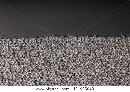 Hand Made Gray Fabric On A Dark Background.