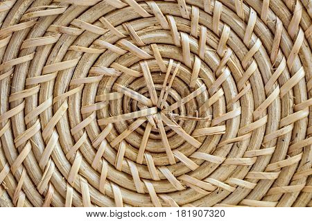 Wicker natural background. Rural weaving with natural straw. Ecological handmade items.