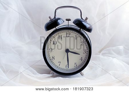 Alarm clock with beep. Vintage round mechanical watch. The time in retro style. The device, which reliably Wake a person. Minutes and seconds on the dial.