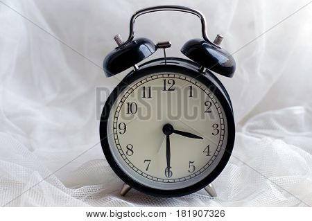 Alarm clock with beep alarm sound. Vintage round mechanical watch. The time in retro style. The device, which reliably Wake a person. Minutes and seconds on the dial.