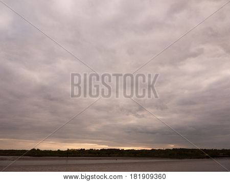 Low Tide Summer Sky Nightfall Grey Clouds Mood And Reds With River Running Through In Wivenhoe Essex