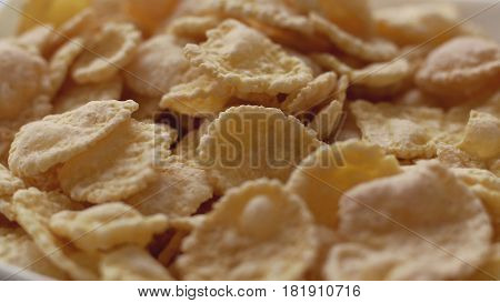 Corn flakes in white bowl. Close up view. Concept of breakfast.