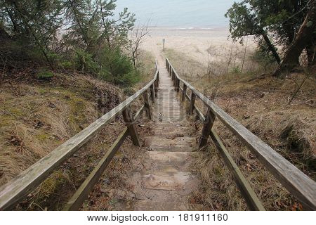 A wooden stairs lead down to a Lake Michigan beach.  Sleeping Bear Dunes National Lakeshore