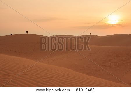 People At Red Sand Dune During Sunset In Mui Ne