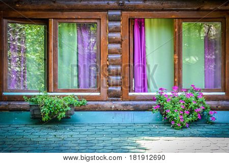 windows with colorful curtains at a farmhouse in Serbia