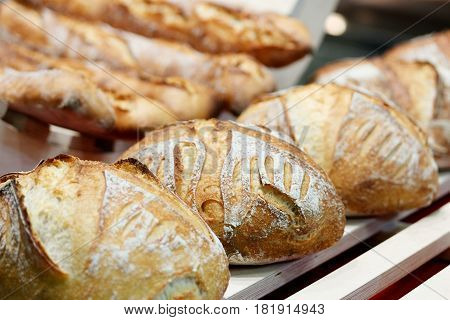 Fresh baked artisan bread at the bakery. Selective focus.