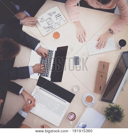 Business people sitting and discussing at business meeting, in office.
