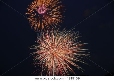Sharp image of multiple fireworks bursting in a black sky. Vivid and clear long exposure of fireworks in night sky. Beautiful display of fireworks bursting in black sky. poster