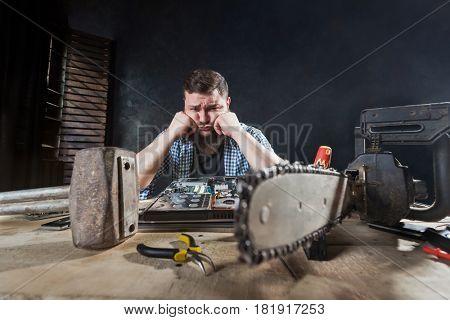 Engineer repairs laptop, repairman fix problem