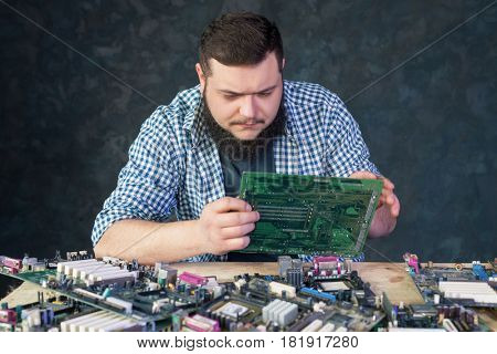 Service engineer work with broken pc hardware