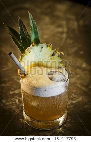 pineapple mango tropical rum fruity cocktail drink in bar