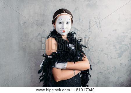 Pantomime actress with makeup posing in studio