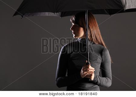 Protection And Cover Young Woman Under Umbrella