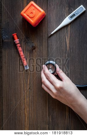stethoscope, hand, toys on children's doctor office wooden desk background top view mockup