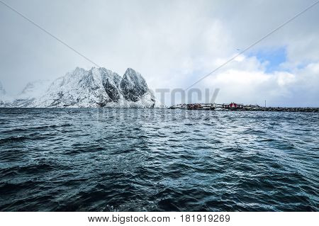 Magnificent snow-covered rocks on a sunny day. Beautiful Norway landscape. Lofoten islands.